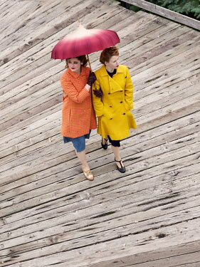 Elisabeth Ansley TWO WOMEN WITH UMBRELLA ON BOARDWALK