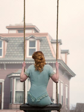 Elisabeth Ansley WOMAN WITH RED HAIR ON SWING BY HOUSE