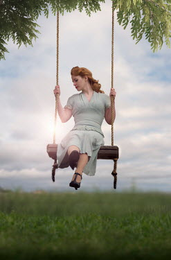 Elisabeth Ansley RETRO WOMAN WITH RED HAIR ON SWING