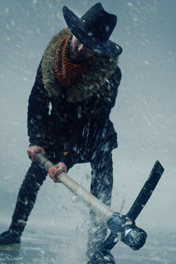 Kirill Sakryukin MAN HITTING ICE WITH PICKAXE