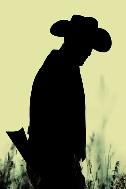 Magdalena Russocka silhouette of cowboy man with rifle