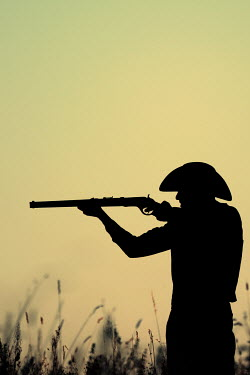 Magdalena Russocka silhouette of cowboy man aiming with rifle