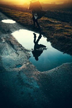 Magdalena Russocka woman reflected in puddle
