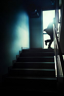 Magdalena Russocka modern man running up staircase of modern building