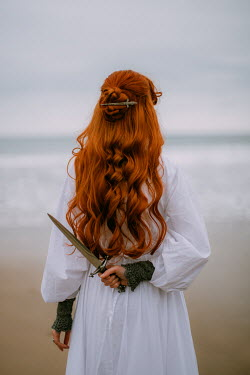 Rebecca Stice WOMAN WITH RED HAIR HOLDING DAGGER BY SEA