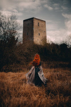 Rebecca Stice MEDIEVAL WOMAN WITH RED HAIR WATCHING CASTLE