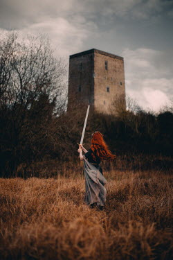 Rebecca Stice MEDIEVAL WOMAN WITH RED HAIR AND SWORD BY CASTLE