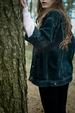 Shelley Richmond GIRL IN DENIM JACKET STANDING BY TREE