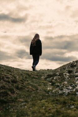 Shelley Richmond GIRL WITH LONG HAIR ON HILL AT DUSK