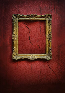 Lyn Randle EMPTY PICTURE FRAME ON CRACKED WALL