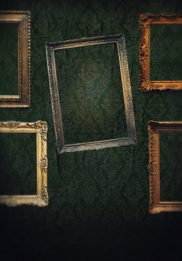 Lyn Randle EMPTY PICTURE FRAMES ON SHABBY WALL