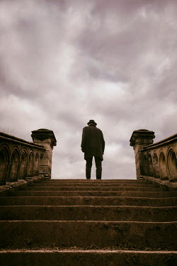 Tim Robinson MAN IN HAT ON GRAND STONE STEPS OUTDOORS