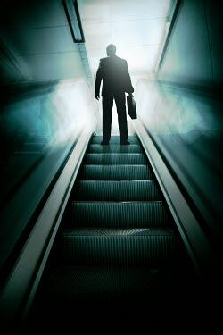 Magdalena Russocka modern man holding briefcase standing on escalator