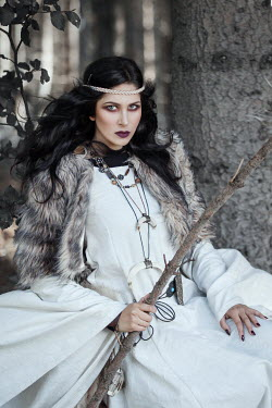 Anna Sychowicz WOMAN IN WHITE AND FUR WITH STICK OUTDOORS