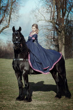 Anna Sychowicz MEDIEVAL WOMAN ON HORSE IN COUNTRYSIDE