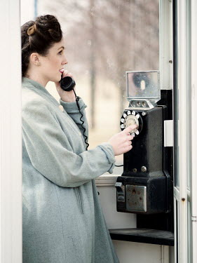 Elisabeth Ansley RETRO WOMAN TALKING IN TELEPHONE BOX