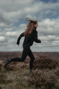 Shelley Richmond GIRL RUNNING IN FLAT COUNTRYSIDE