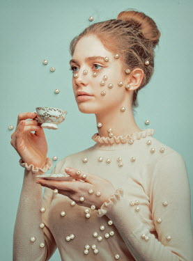 Tijana Moraca GIRL DRINKING FROM TEACUP COVERED WITH PEARLS