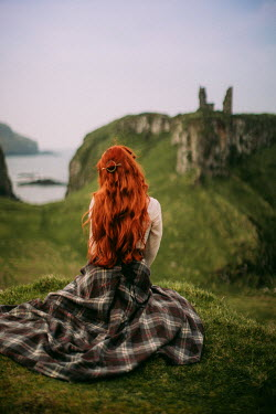 Rebecca Stice WOMAN WITH RED HAIR WATCHING COASTAL RUINS