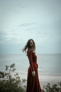 Natasza Fiedotjew woman in red dress standing by sea