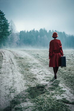 Natasza Fiedotjew vintage woman with suitcase on country road