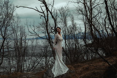 Katerina Klio WOMAN IN WHITE LACE BY FROZEN LAKE