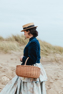 Matilda Delves HISTORICAL WOMAN WITH HAT AND BASKET ON BEACH