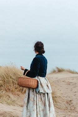 Matilda Delves HISTORICAL WOMAN CARRYING BASKET ON BEACH