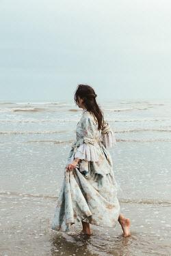 Matilda Delves HISTORICAL BRUNETTE WOMAN PADDLING IN SEA