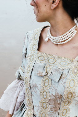 Matilda Delves HISTORICAL WOMAN WITH PEARL NECKLACE OUTDOORS