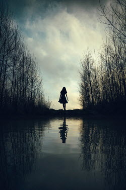Magdalena Russocka silhouette of young girl standing by water