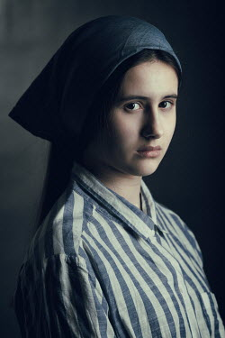 Magdalena Russocka young girl wearing striped shirt and headscarf inside