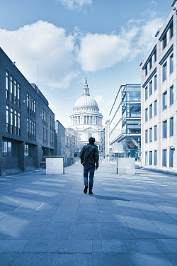 CollaborationJS MAN WALKING IN LONDON WITH ST. PAULS CATHEDRAL