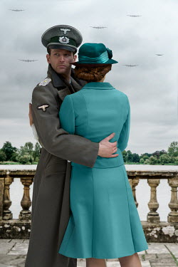 CollaborationJS GERMAN OFFICER EMBRACING WOMAN OUTDOORS
