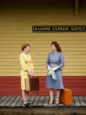 Elisabeth Ansley RETRO WOMEN WITH SUITCASES ON RAILWAY PLATFORM