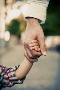Kerstin Marinov FATHER HOLDING CHILD'S HAND OUTDOORS