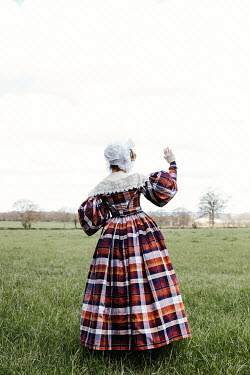 Matilda Delves HISTORICAL WOMAN WITH LACY BONNET IN FIELD
