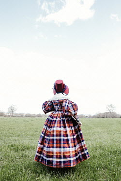 Matilda Delves HISTORICAL WOMAN WITH BONNET IN FIELD