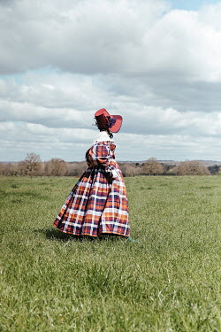 Matilda Delves HISTORICAL WOMAN WITH BONNET WALKING IN FIELD