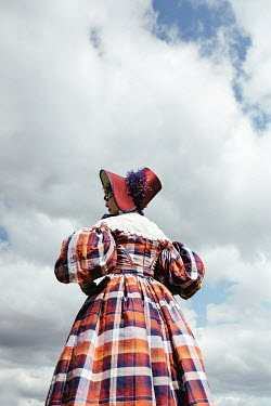 Matilda Delves HISTORICAL WOMAN WITH BONNET STANDING OUTDOORS