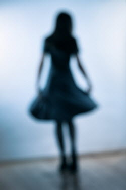 Magdalena Russocka blurred young girl wearing dress inside