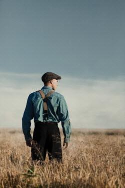 Magdalena Russocka vintage man standing in field