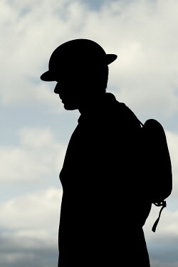 Magdalena Russocka silhouette of wartime soldier standing outside