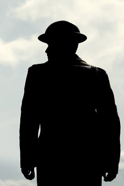 Magdalena Russocka silhouette os wartime soldier standing outside