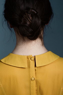 Magdalena Russocka close up of young woman in blouse with collar from behind
