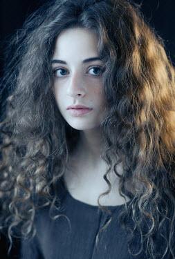 Irina Orwald SERIOUS GIRL WITH LONG WAVY HAIR