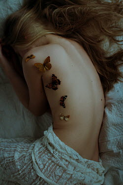 Irina Orwald GIRL LYING ON BED COVERED WITH BUTTERFLIES