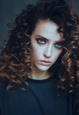 Irina Orwald SERIOUS GIRL WITH CURLY HAIR BY WINDOW