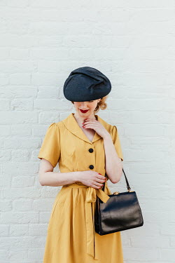 Matilda Delves 1940S WOMAN IN YELLOW DRESS WITH HAT AND HANDBAG