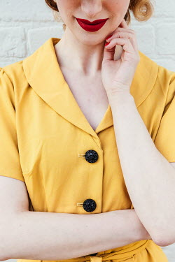 Matilda Delves 1940S WOMAN WITH YELLOW DRESS AND RED LIPSTICK